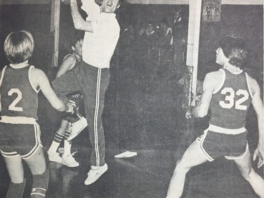 Bernie Ginsburg leaps to shoot during the father/son basketball game at St. Ann's in January 1981. The fathers won the game in overtime, 84-82. The event raised money for St. Jude's Children's Hospital in honor of Brian Joseph French who passed away in late 1980. French was a 5th grade student at St. Ann's.