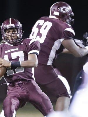 Kwatrivous Johnson blocks for his quarterback during a game last season.