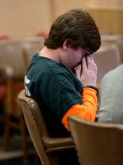 Dylan Carver, 15, has a moment to himself while listening to testimony from witnesses during a preliminary hearing at the Portage County Circuit Court, September 13, 2016. He is heading to adult court for the stabbing of a 60-year-old female relative.
