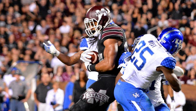 ; Mississippi State Bulldogs tight end Darrion Hutcherson (84) comes down with a pass in the end zone as he is defended by Kentucky Wildcats safety Darius West (25) during the third quarter of the game against the Kentucky Wildcats at Davis Wade Stadium. Mississippi State won 42-16 Mandatory Credit: Matt Bush-USA TODAY Sports