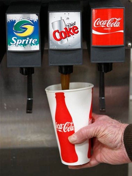 Diet soda might seem like a good alternative to the high calorie regular stuff, but some experts suggest avoiding it. (AP Photo/Paul Sakuma, File)