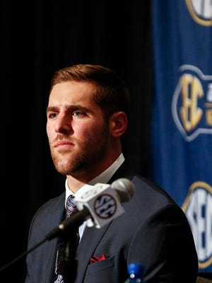 Texas A&M quarterback Trevor Knight speaks to the media at the Southeastern Conference NCAA college football media days, Tuesday, July 12, 2016, in Hoover, Ala. (AP Photo/Brynn Anderson)