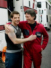 "FILE - In this May 19, 2004 file photo, actors Jamie Bamber, left, and Richard Hatch share a laugh outside their trailers while waiting to be called on to the set during the filming of the Sci-fi channel's ""Battlestar Galactica,"" in Surrey, British Columbia. Hatch, perhaps best known for playing Captain Apollo in the original ""Battlestar Galactica"" film and TV series, has died at age 71. A representative for the actor says Hatch died Tuesday afternoon, Feb. 7, 2017, after a battle with pancreatic cancer."