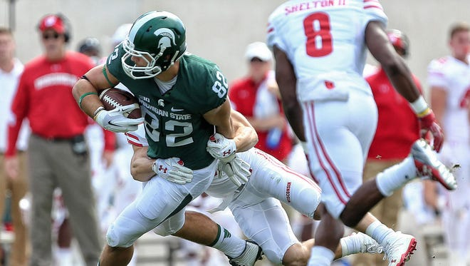 Sep 24, 2016; East Lansing, MI, USA; Michigan State Spartans tight end Josiah Price makes a catch for a first down during the first quarter against the Wisconsin Badgers at Spartan Stadium.
