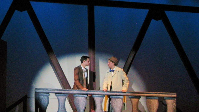 George Bailey (Nick Lahuey, on the left)) is in a suicidal mood. He meets his guardian angel, Clarence, (Patrick Jones) on the bridge.