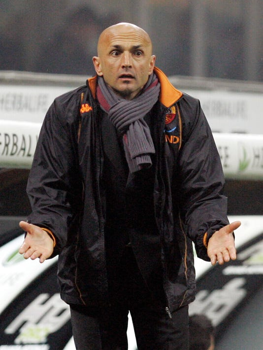 FILE - In this March 1, 2009 file photo, then Roma coach Luciano Spalletti gestures during the Serie A soccer match between Inter Milan and Roma at the San Siro stadium in Milan, Italy. In a statement released Wednesday, Jan. 13, 2016, Roma soccer club announced that it has fired coach Rudi Garcia after only one win in its last 10 matches in all competitions. While no immediate replacement was announced, Luciano Spalletti was widely expected to be hired for his second stint in charge of the Serie A club. (AP Photo/Antonio Calanni, files)