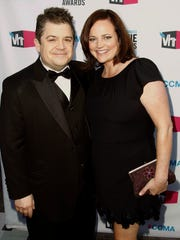 In this Jan. 12, 2012, file photo, Patton Oswalt and wife Michelle McNamara arrive at the 17th Annual Critics' Choice Movie Awards in Los Angeles.