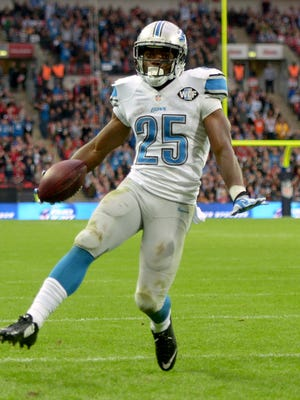 Detroit Lions running back Theo Riddick scores on a five-yard touchdown reception in the fourth quarter against the Atlanta Falcons at Wembley Stadium.