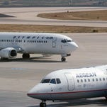 Aegean Airlines and Olympic Air aircraft at Athens International Airport in a file photo from Sept. 23, 2005.
