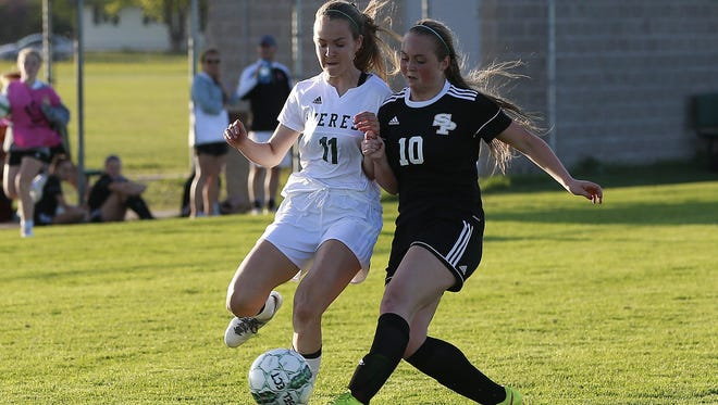Everest's Sarah Lorge, left, and SPASH's Julia Mode battle for the ball during a  Wisconsin Valley Conference girls soccer game Tuesday.