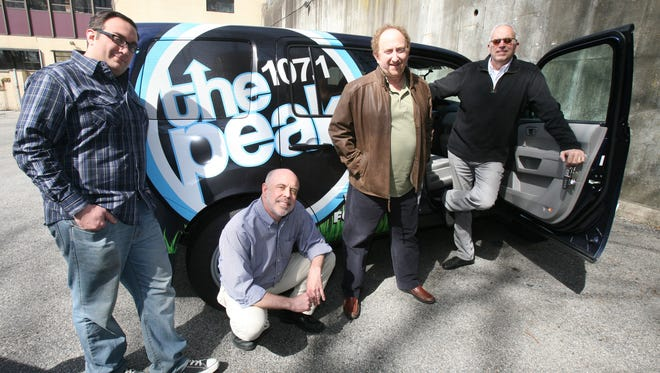 "The Peak 107.1 celebrates their 10th anniversary this April. Pictured at their studio in White Plains are Chris ""Coach"" Rodriguez, the morning personality; Chris Herrmann, program director and mid-day personality; Rob Arrow, music director and Jimmy Fink, afternoon personality."