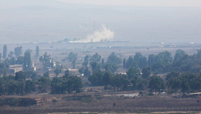 Smoke caused by fighting in Syria is seen from the Israeli-controlled Golan Heights, close to the border with Syria, Monday.