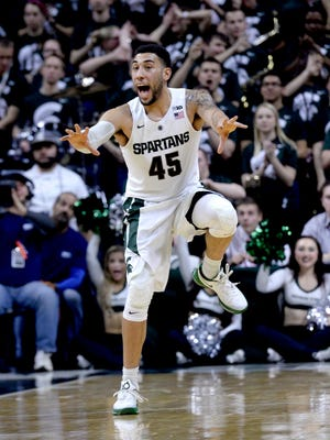 Denzel Valentine tries to get his teammates attention as the Spartans get back on defense on a fast break in the second half of the Spartans 72-71 loss to Nebraska Wednesday, Jan. 20, 2016, at the Breslin Center in East Lansing. The loss drops MSU to 16-4, 3-4 in the Big Ten.