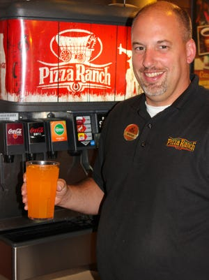 Orange City General Manager, Schuyler Noteboom, general manager of the Orange City, Iowa, Pizza Ranch, poses with the newly offered Barrilitos Aguas Frescas Mango Lime drink.