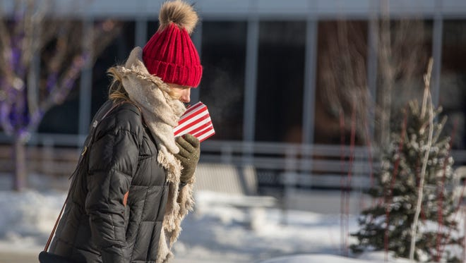 A woman is bundled up as she walks in subzero weather Jan. 2, 2018, in South Bend, Ind.
