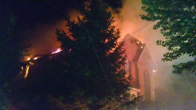 A Canton house burns after officials say it was struck by lightning.
