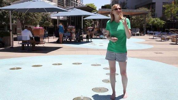 Joanna Allhands venturing out onto an Arizona splashpad. Credit: Diana Payan/azcentral.com