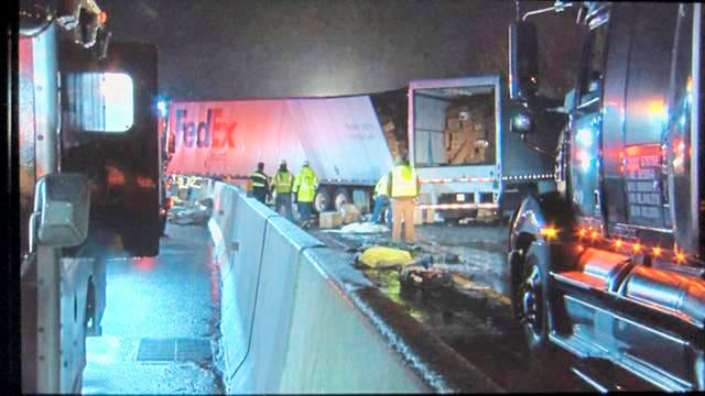 Emergency crews respond to a fatal crash on the Pennsylvania Turnpike in Mount Pleasant Township early Sunday morning. Multiple people were killed early Sunday in a crash involving a passenger bus, two tractor-trailers and passenger vehicles in Pennsylvania, officials said.