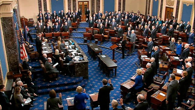 In this image from video, presiding officer Supreme Court Chief Justice John Roberts swears in members of the Senate for the impeachment trial against President Donald Trump at the U.S. Capitol in Washington on Thursday.