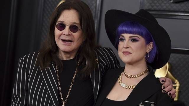 Ozzy Osbourne, left, and Kelly Osbourne arrive at the 62nd annual Grammy Awards at the Staples Center on Jan. 26 in Los Angeles.