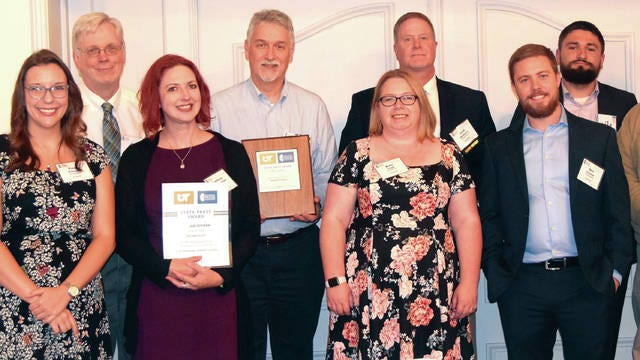 Herald-Citizen staff. From left: reporters Paige Stanage and Jim Herrin, managing editor Lindsay McReynolds, news editor Don Foy, city editor Kate Cook, publisher Jack McNeely, sports writer and photographer Ben Craven, reporter Ben Wheeler and sports editor Scott Wilson.