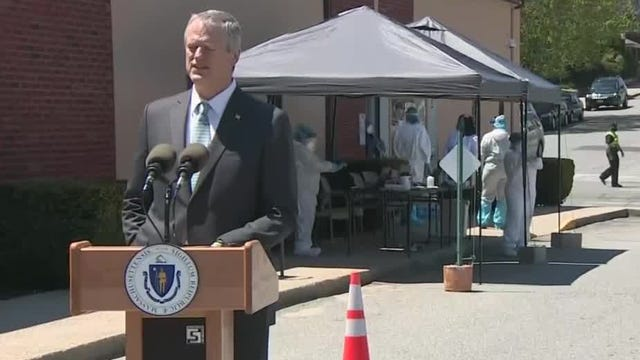 Gov. Charlie Baker, seen here in May visiting a drive-through coronavirus testing facility in Fall River, on Wednesday said more than two months after Massachusetts embarked on its gradual economic and social reopening plan, the rate of positive COVID-19 tests is lower than it was before pandemic-shuttered businesses first began stirring back to life.