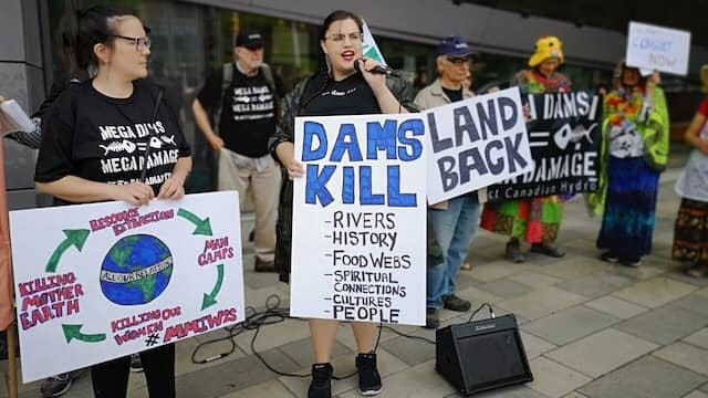 Canadians who support indigenous rights speak out against hydrolic power initiatives that have constructed dams and clear-cut indigenous lands.