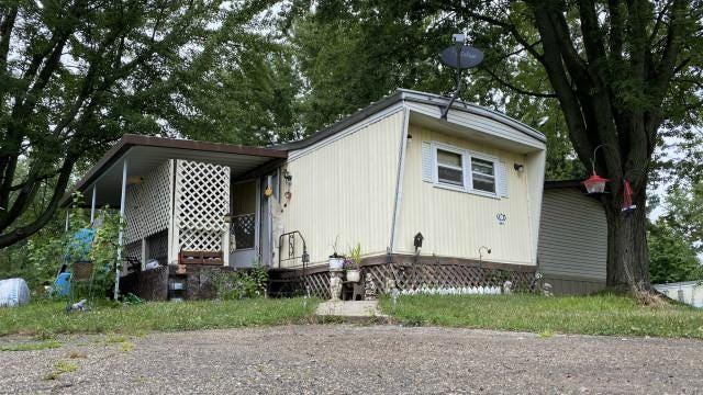 The home at the Lakewood Mobile Estates in Lake Odessa where police say a woman was killed Monday, Aug. 3.