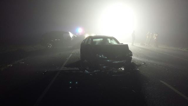 A crash that left one dead and sent two to the hospital closed Highway 99E for more than six hours Monday night.