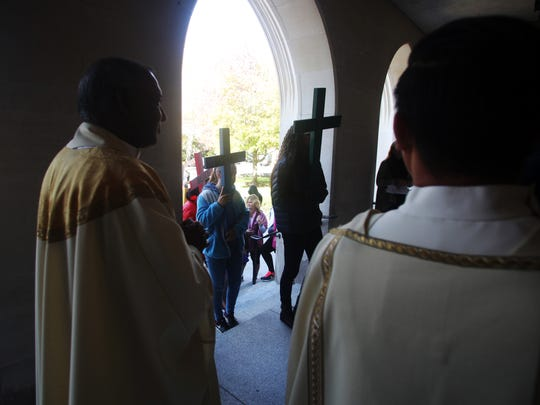 """Parishioners from throughout the Diocese of Metuchen enter the Cathedral of St. Francis of Assisi following the walk-a-thon entitled """"Going the Extra Mile for Kids in Need of Jesus"""", Sunday, October 18, 2015, as part of World Mission Sunday in Metuchen, NJ."""