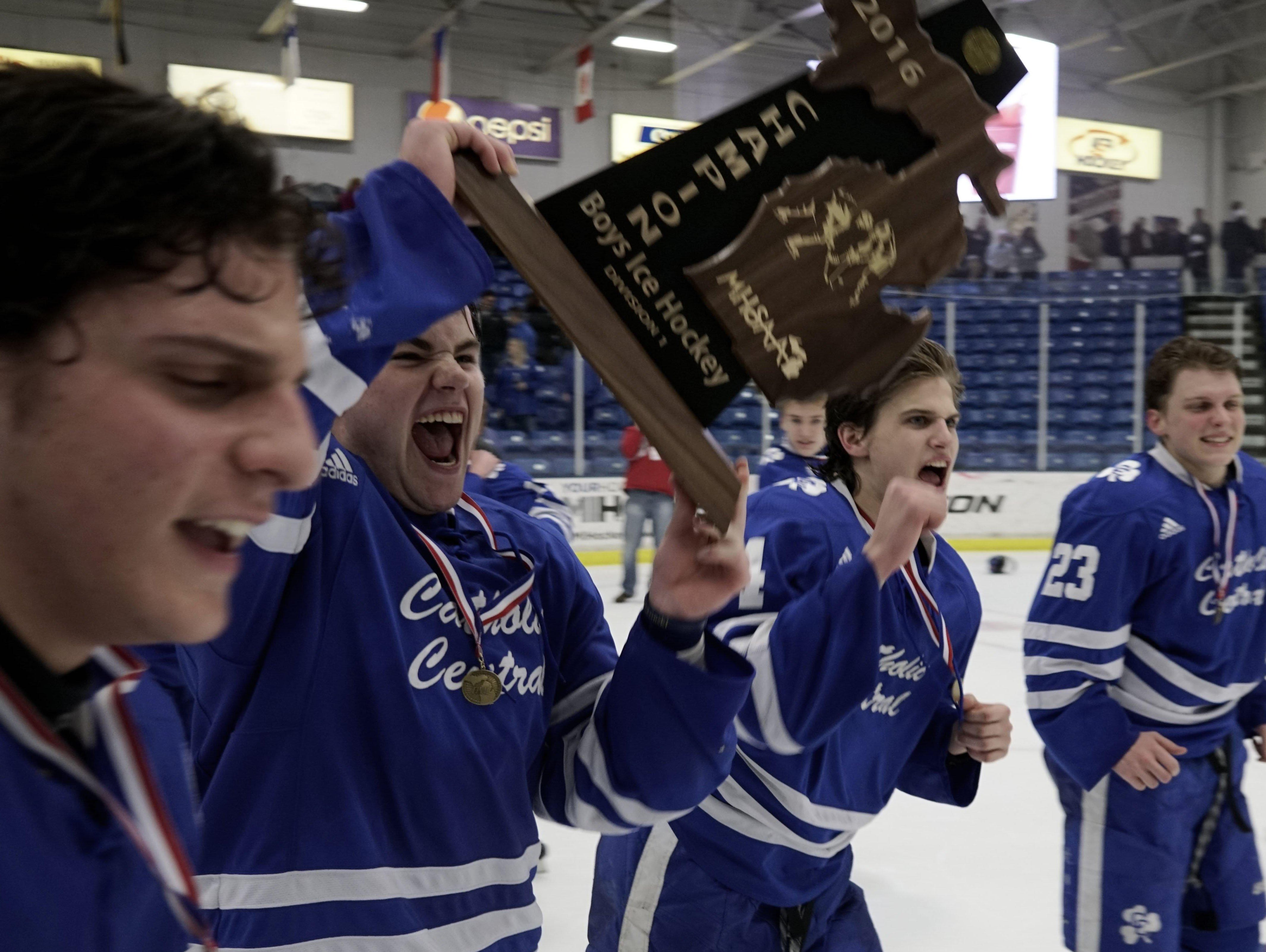 Detroit Catholic Central celebrates their win at the Division 1 Boys' Ice Hockey Final on Saturday, Mar. 12, 2016 at the USA Hockey Arena in Plymouth. Detroit Catholic Central had a shut-out win, 3-0 over Brighton. Tim Galloway/Special to DFP