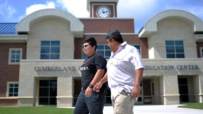 "Incoming CCTec engineering technology freshman Martin Adame,14, of Bridgeton, walks on the new campus with his father Martin Adame following a press event there Wednesday, Aug. 10, 2016 in Vineland.  ""Something good is going to come out of this school!"" exclaimed the elder Adame before walking away with an arm around his son's shoulders."