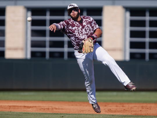 Jake Burger throws the ball to first during the MSU