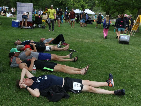Runners are seen resting after finishing the Reno-Tahoe