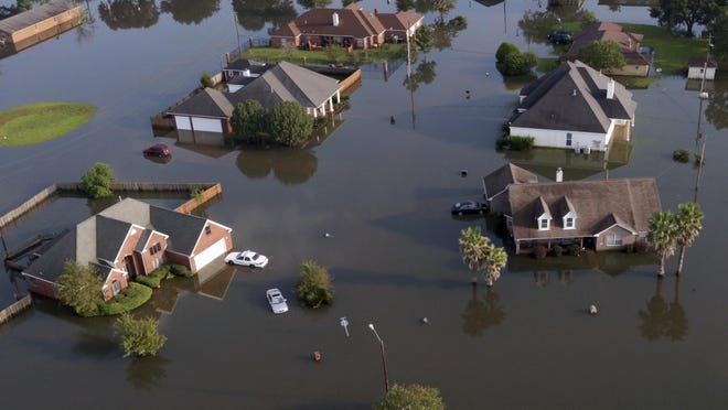 In this aerial photo, homes sit in floodwaters caused by Hurricane Harvey in Port Arthur, Texas, on Sept. 1. Port Arthur's major roads were swamped by rising waters brought by Harvey.