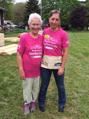 Mary Palmberg, left, and Tricia Brown are pictured at the Habitat for Humanity Women Build project on Friday. They helped frame the walls of a home that will be built in Palmberg's honor on Prairie du Chien Road in Iowa City.