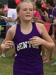 A Benton runner heads to the finish line in the middle