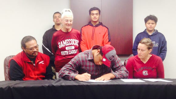 Asheville High senior Pete Leota signed to play college football for South Carolina on Wednesday morning.