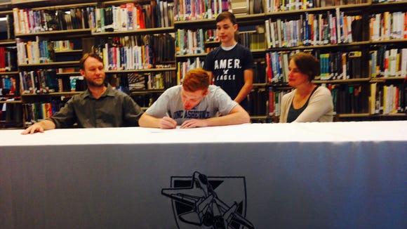 Enka senior Sage Turner has signed to run college cross