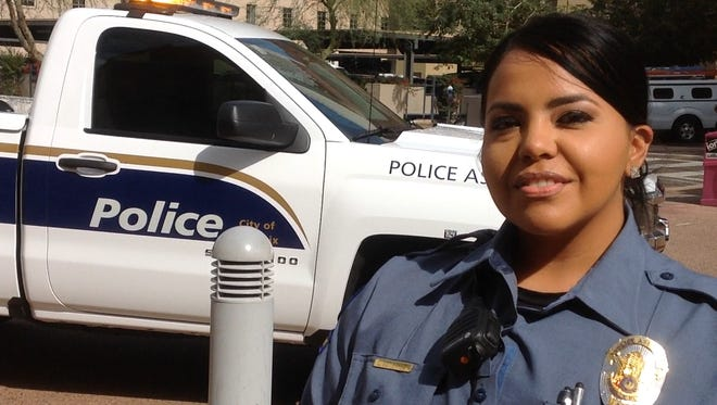 Phoenix Police Assistant, Lisa Gutierrez, displays new uniform and vehicle at Phoenix City Hall on Feb. 15.