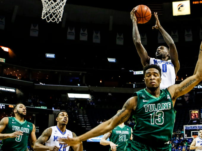 December 29, 2015 - Memphis' Trahson Burrell goes up for a shot against the Tulane defense during first half action at the FedExForum. Memphis was down to Tulane 35-37 a the half.