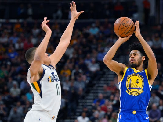 Golden State Warriors guard Quinn Cook (4) shoots over Utah Jazz guard Dante Exum (11) in the first half of an NBA basketball game Tuesday, April 10, 2018, in Salt Lake City. (AP Photo/Alex Goodlett)