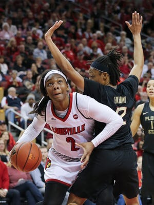 U of L's MyishaHines-Allen (2) looks for room to operate against FSU's Nicole Ekhomu (12) during their game at the KFC Yum! Center.  Jan. 21, 2017