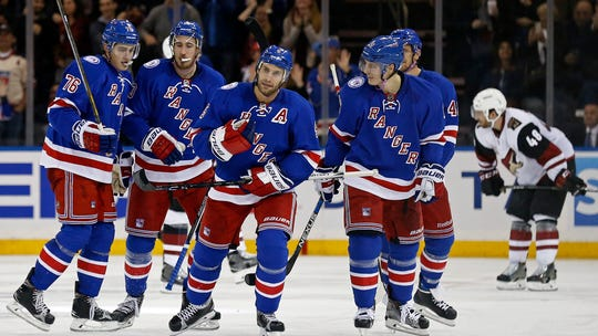 New York Rangers defenseman Dan Girardi (5) celebrates