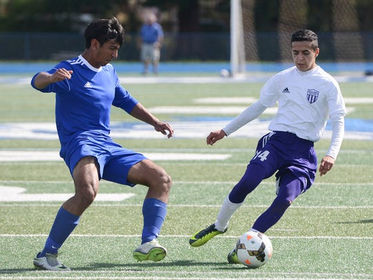 Anderson High's Alfredo Lopez, left, tries to steal the ball from Willows' Miguel Hernandez during the 2016-17 Northern Section All-Star soccer game at Pleasant Valley High School in Chico.