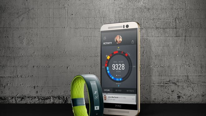 The HTC Grip fitness tracker and HTC One M9 smartphone.