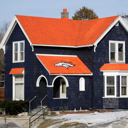 Don Kober's house on 14th Street in Sheboygan is hard to miss with its Denver Bronco football colors.