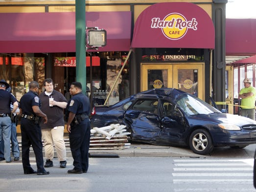 A police chase of a motorist traveling at speeds of more than 100 mph ended in a crash in Downtown Indianapolis where the motorist, driving a white Ford Explorer, struck a blue Ford Taurus at the intersection of Meridian and Maryland streets. The collision sent the Taurus spinning into a nearby bicyclist, who sustained leg and back injuries.