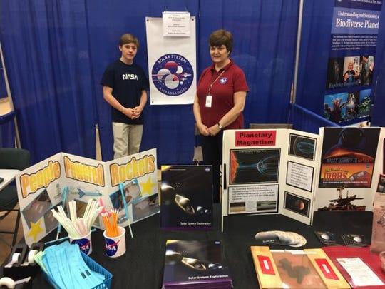 Zachary Hessler with science teacher Melissa Sleeper.