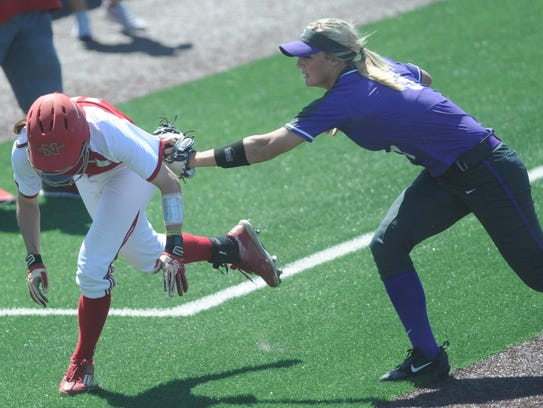 ACU third baseman Casey-May Huff, right, tags out Nicholls